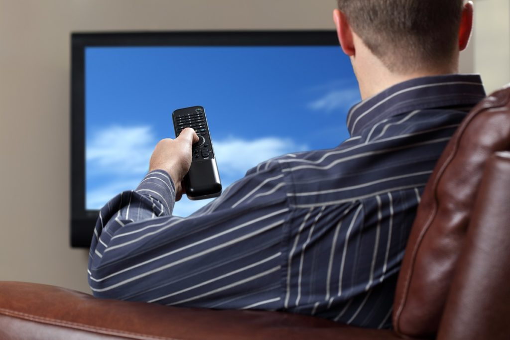 Man watching the television