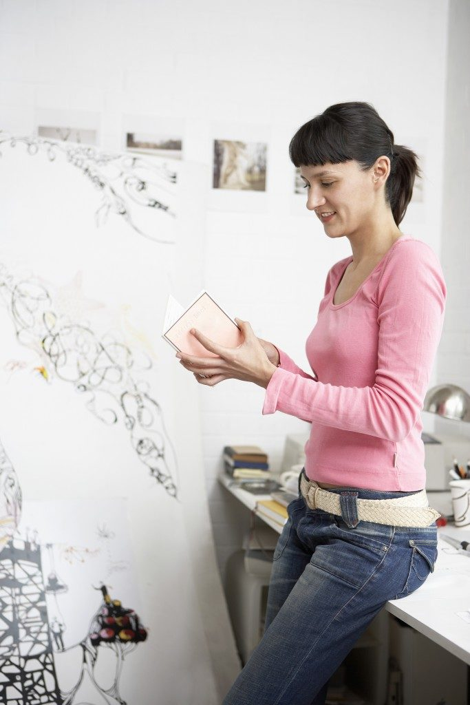woman creating a painting