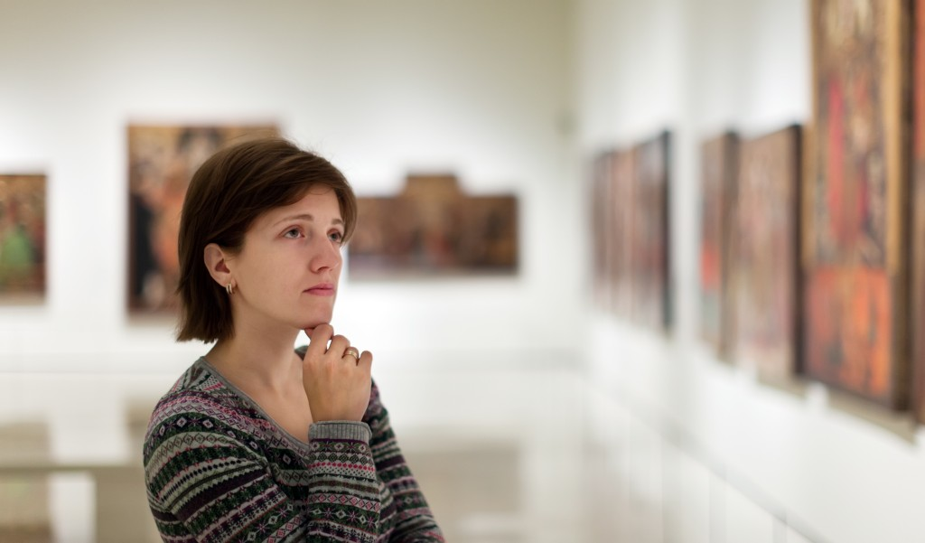 woman appreciating art in gallery