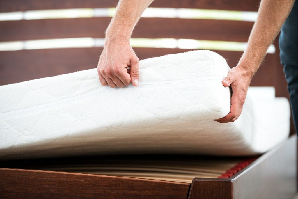 Man testing the quality of the mattress