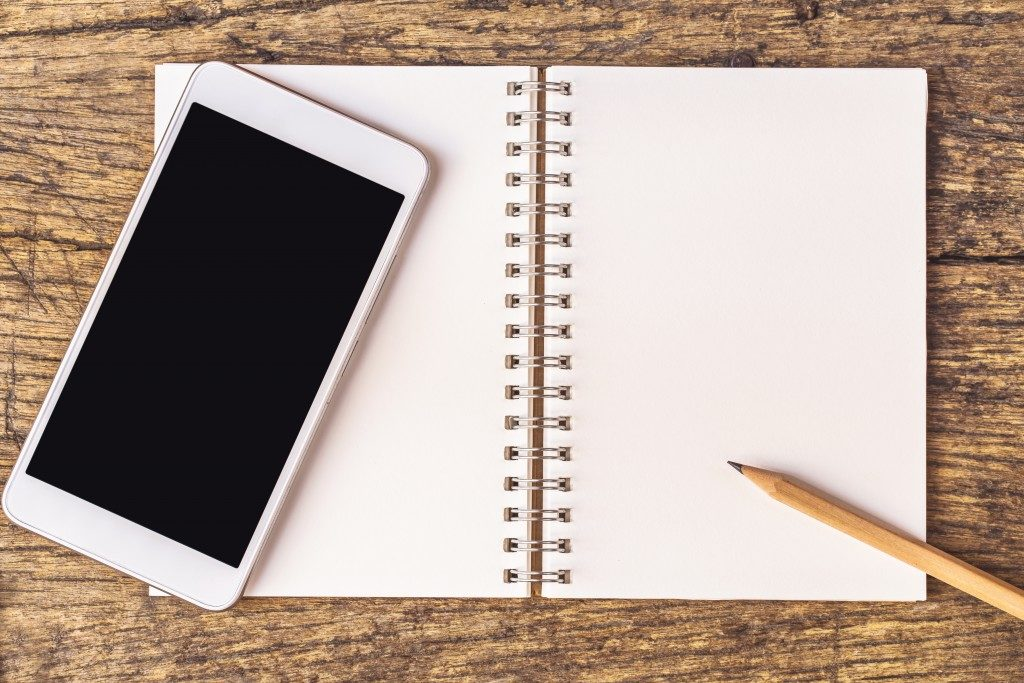 notebook with smart phone