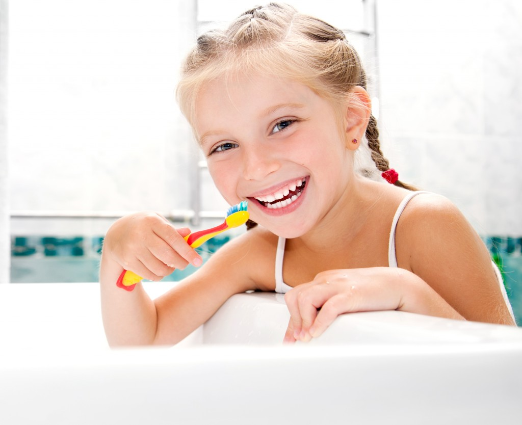 Train Kids to Brush Teeth Regularly for Optimum Health