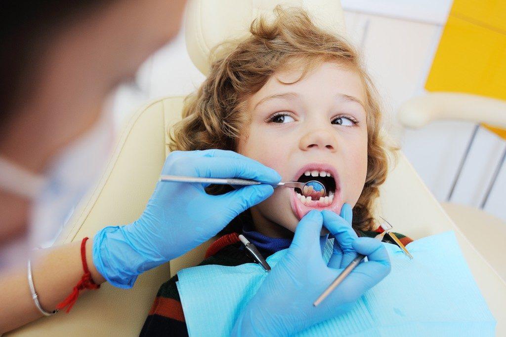 kid having dental checkup