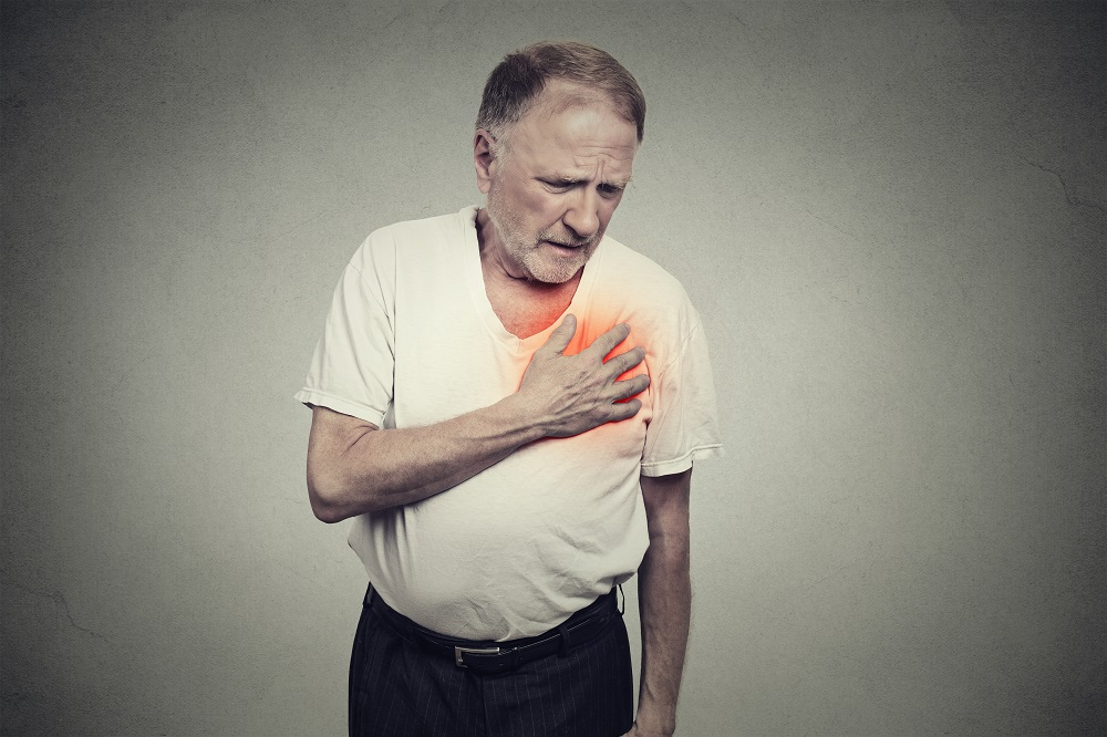 elderly man experiencing pain in the chest