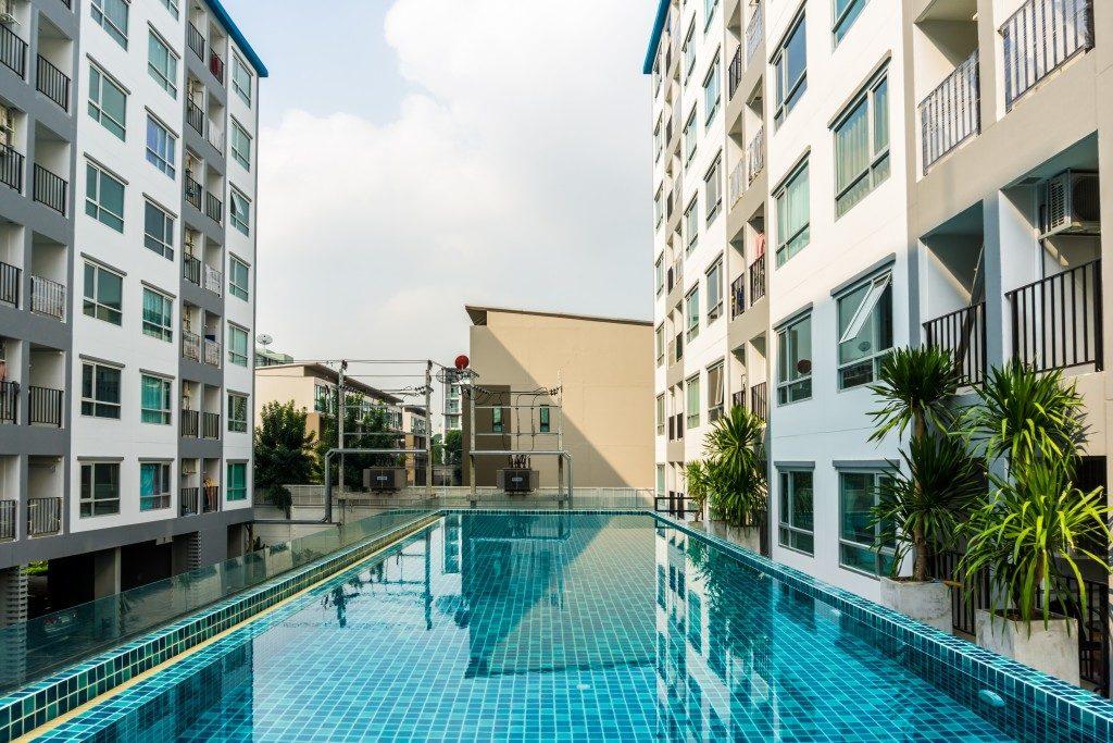 swimming pool among highrise condominium buildings