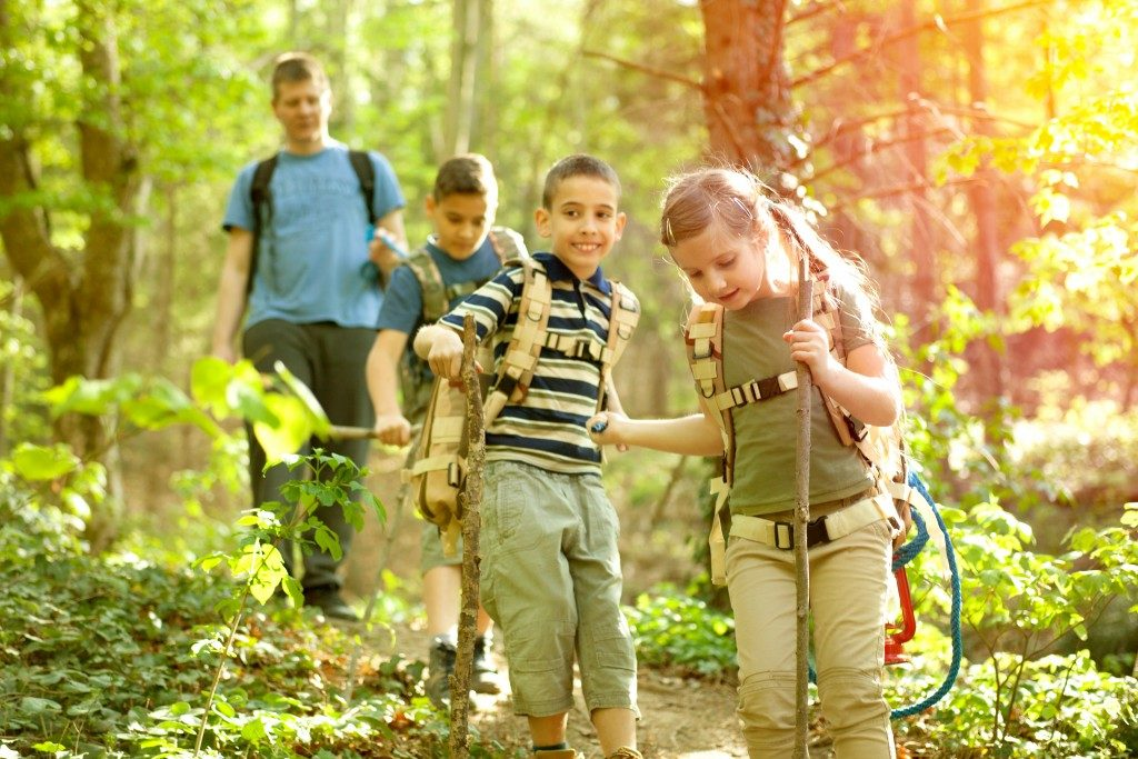 Kids out in nature with parent