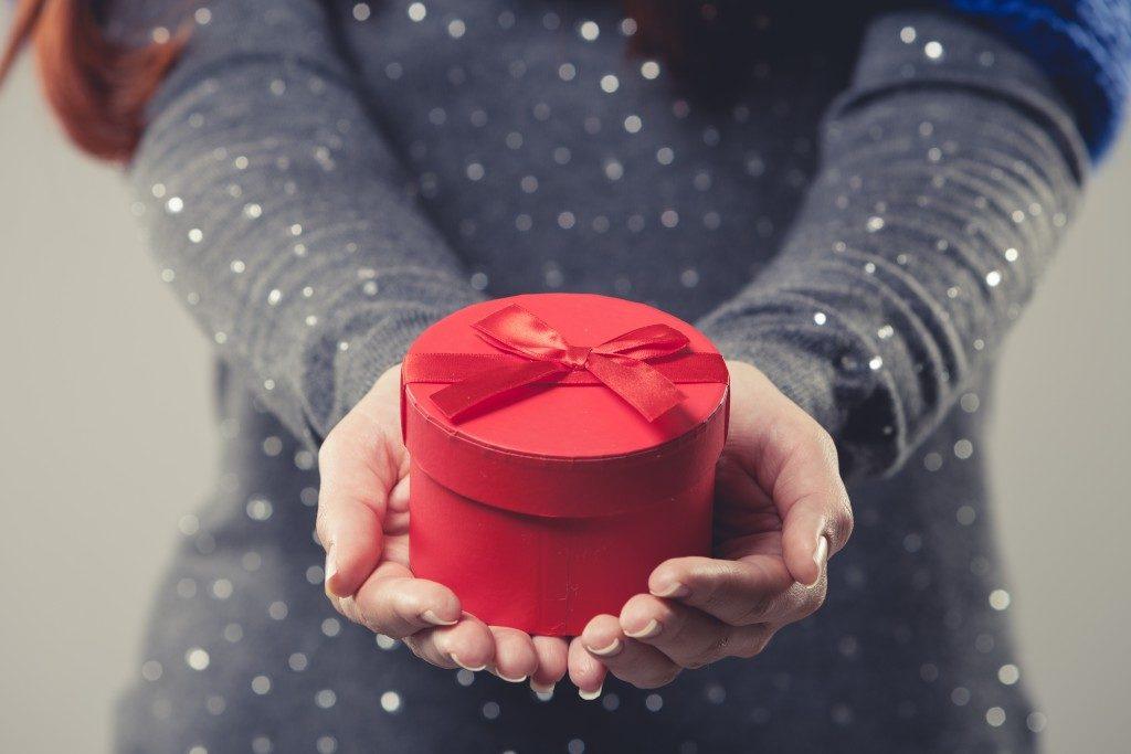 Woman handing a present