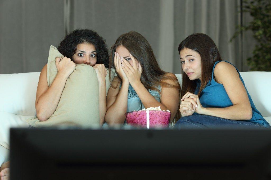 Girls watching a terror movie