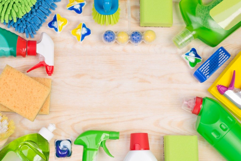 Cleaning supplies on a wooden surface