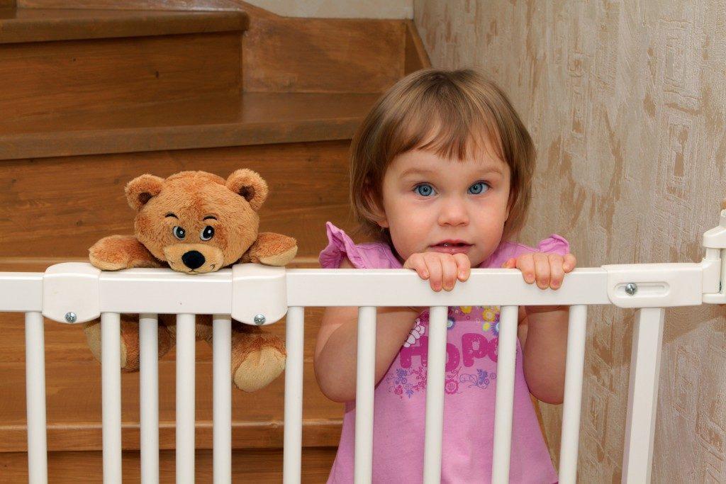 Kid at a stair gate