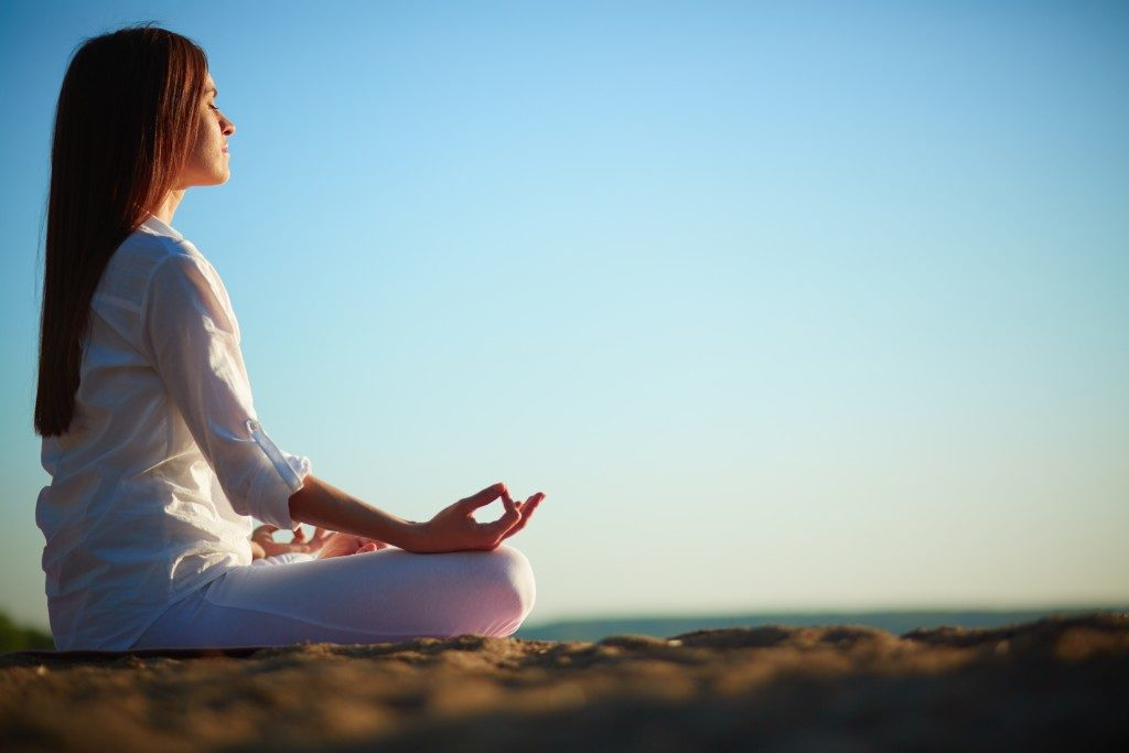 Woman meditating outdoors
