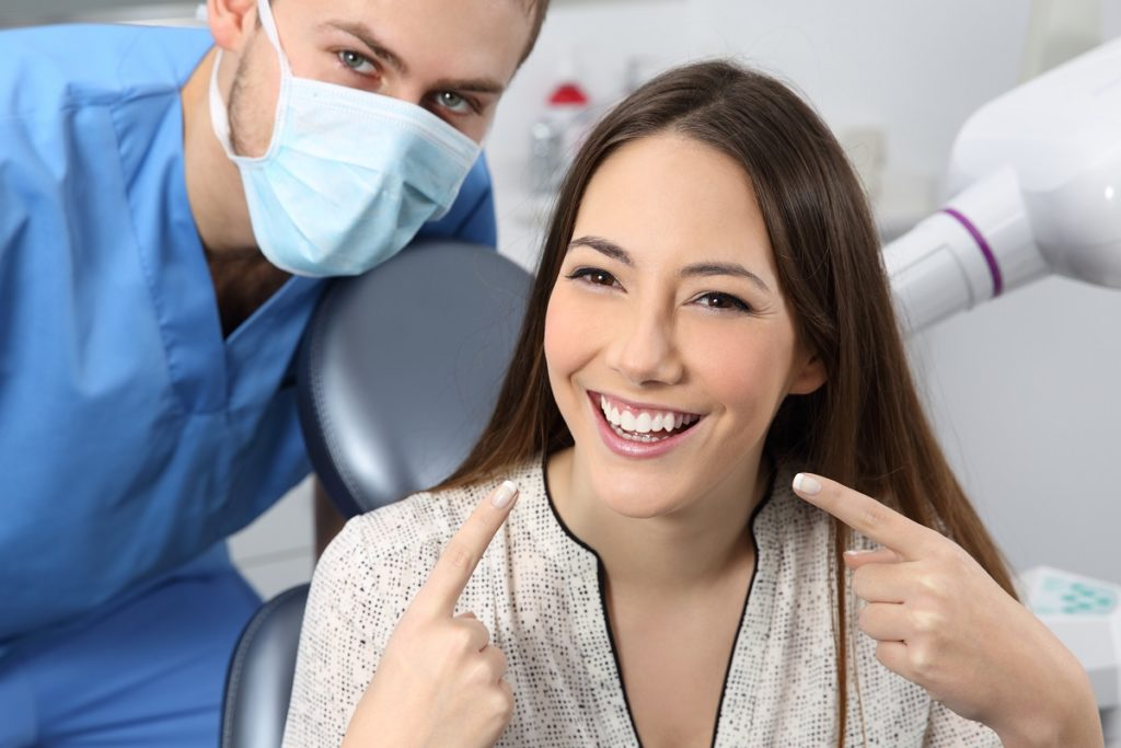 woman happy about her teeth after appointment