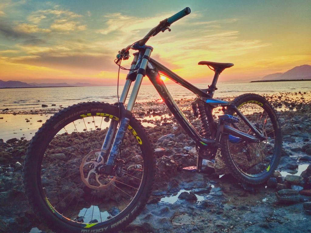 Bike standing next to the shore