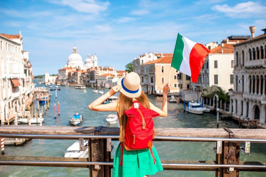 woman waving Italian flag in Venice
