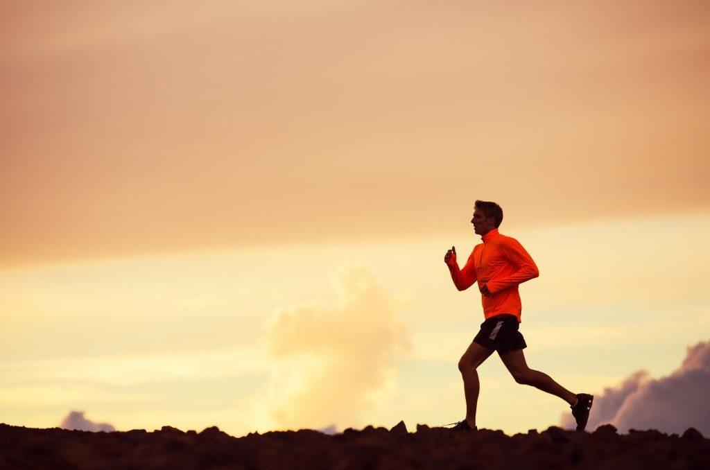 Man running outdoors during sunset