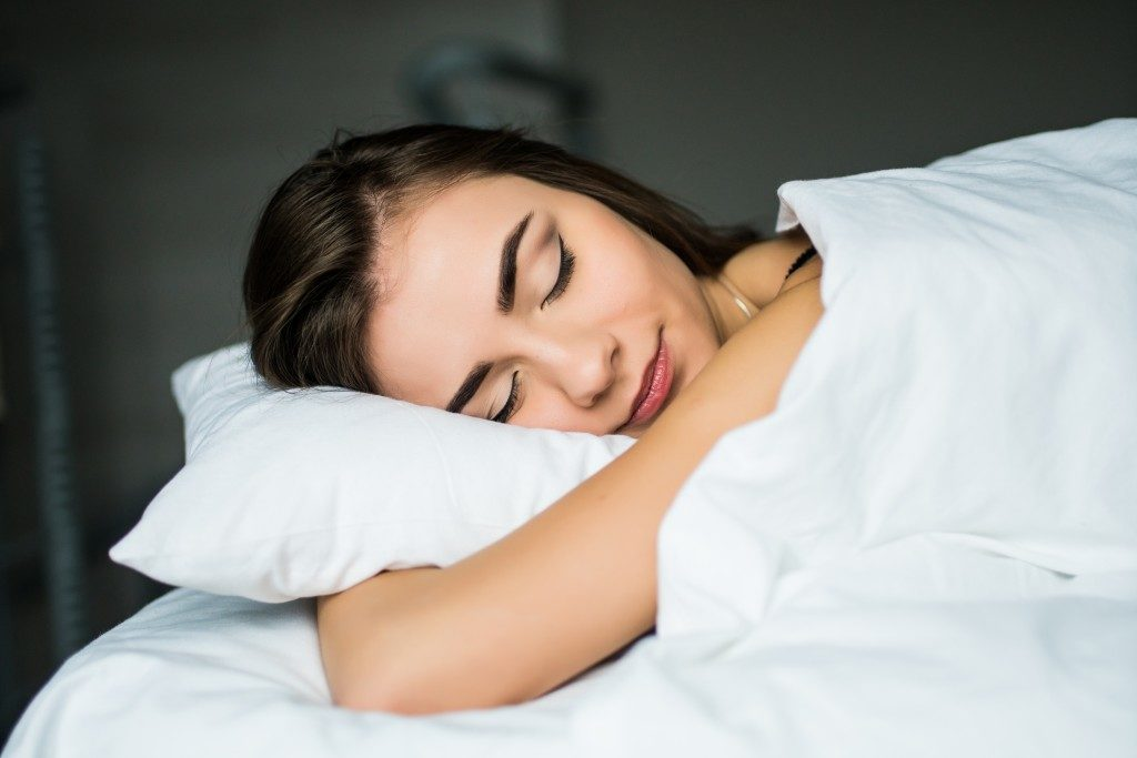 sleeping woman on white linen