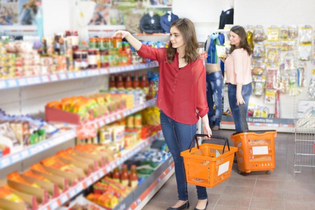 Two women grocery shopping