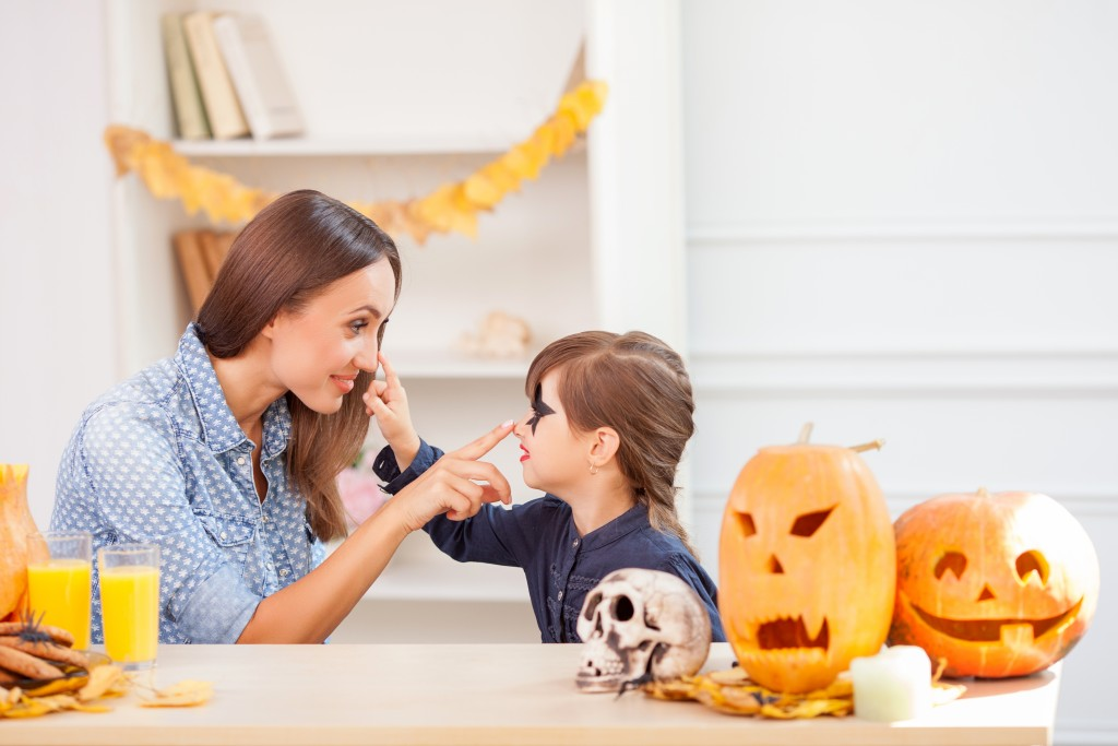 Mom and daughter preparing for halloween