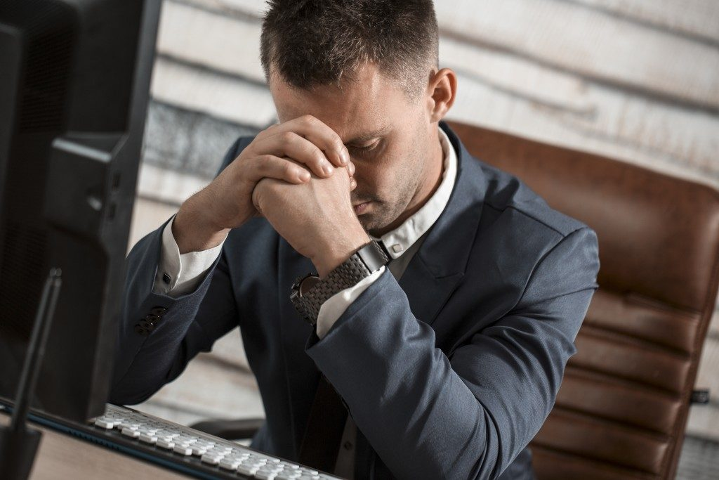 man stressed with work