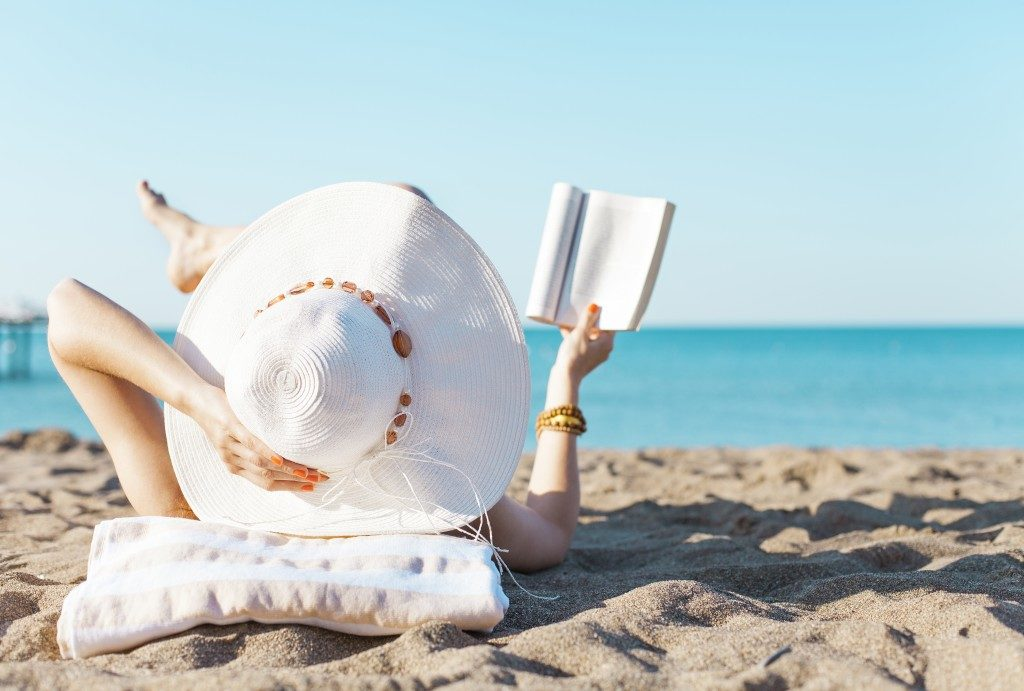 Reading and sunbathing at the beach