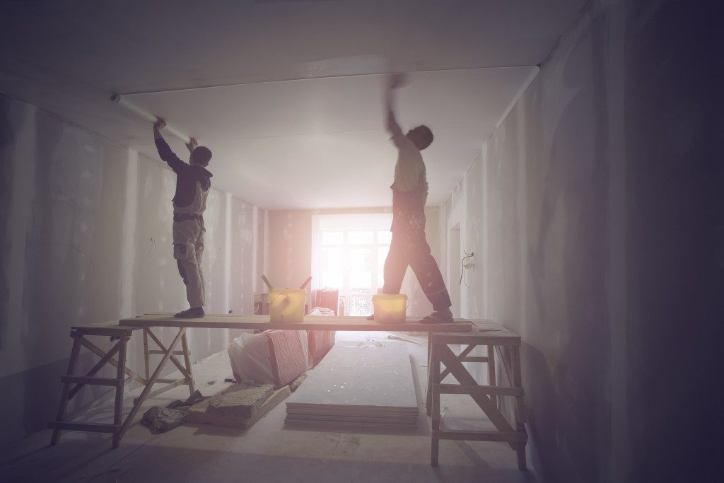 construction workers fixing the house