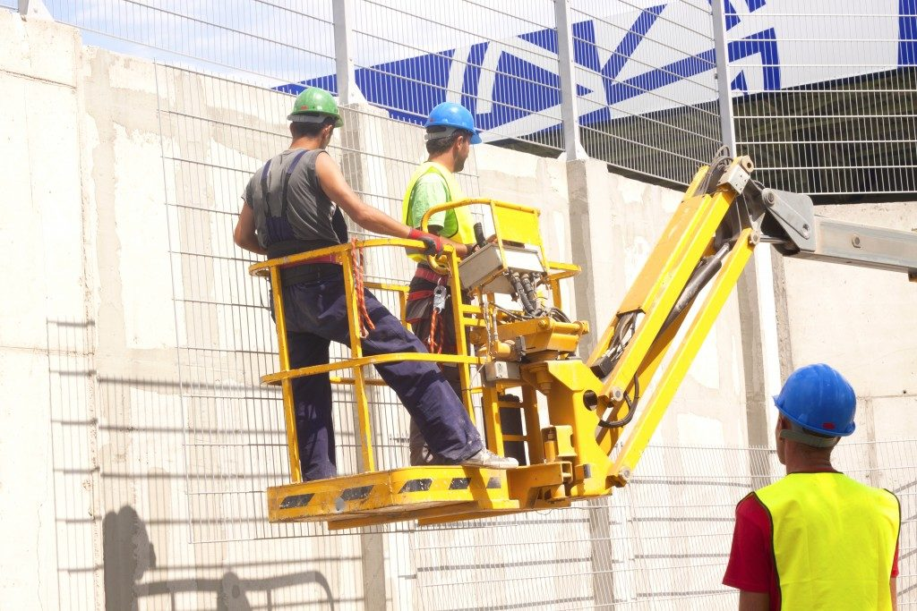 men on a mobile construction platform