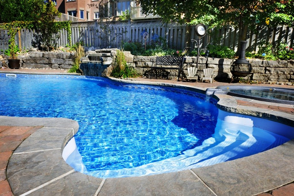swimming pool in a home's backyard